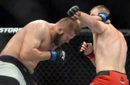 Aug 6, 2016; Salt Lake City, UT, USA; Viktor Pesta (red gloves) and Marcin Tybura (blue gloves) fight during UFC Fight Night at Vivint Smart Home Arena. Tybura won via second round knockout. Mandatory Credit: Joe Camporeale-USA TODAY Sports