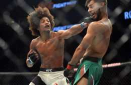 Aug 6, 2016; Salt Lake City, UT, USA; Yair Rodriguez (red gloves) and Alex Caceres (blue gloves) fight during UFC Fight Night at Vivint Smart Home Arena. Rodriguez won via split decision. Mandatory Credit: Joe Camporeale-USA TODAY Sports