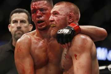 Conor McGregor, right, and Nate Diaz embrace following their welterweight mixed martial arts bout at UFC 202 on Saturday, Aug. 20, 2016, in Las Vegas. McGregor won by split decision. (AP Photo/Isaac Brekken)