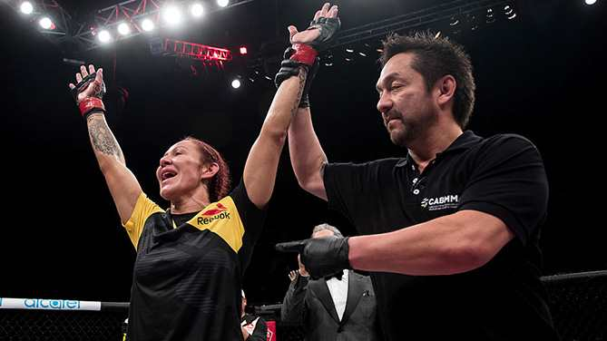 BRASILIA, BRAZIL - SEPTEMBER 24: Cris Cyborg of Brazil celebrates victory over Lina Lansberg of Sweden in their catchweight UFC bout during the UFC Fight Night event at Nilson Nelson gymnasium on September 24, 2016 in Brasilia, Brazil. (Photo by Buda Mendes/Zuffa LLC/Zuffa LLC via Getty Images)